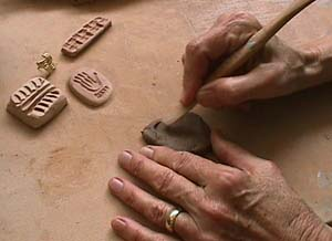 artist Slipper making stamps