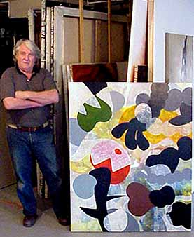 Charles Hewitt with a stenciled painting