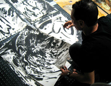 Guillermo Cuello with drawings
