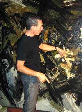 Guillermo Cuello  with painting