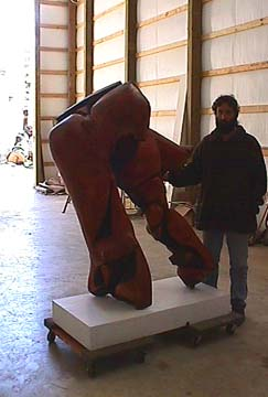 Sculptor Gordon with cherry wood sculpture