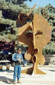 Javier Astorga  with steel sculpture in China