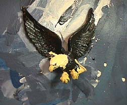 Pop artist John Clem Clarke's detail of painting with plastic eagle