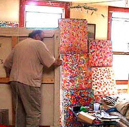Richard Mock moving paintings in Red Hook, Brooklyn studio
