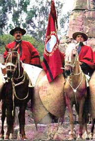 Salteño gauchos with red ponchos
